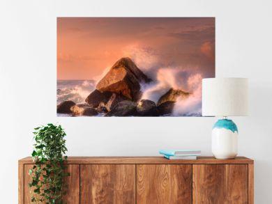 Tropical beach with rocks and big crashing waves
