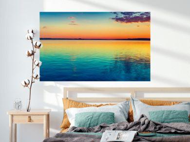 Sunset over the lake. Amazing panorama landscape