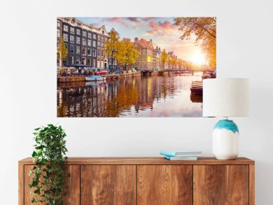 Channel in Amsterdam Netherlands houses river Amstel landmark