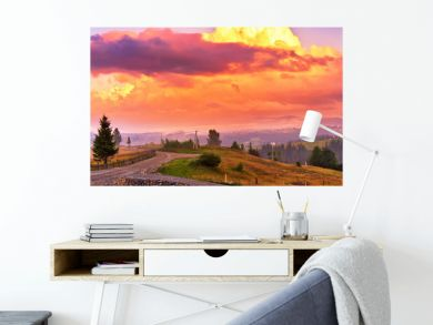 Summer colorful sunset in mountains. Panorama of beautiful evening