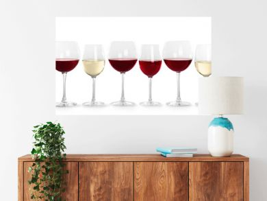 Glasses with different wine on light background
