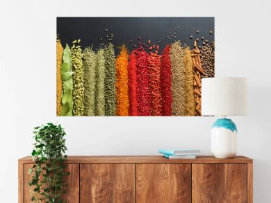 Colorful collection spices and herbs on background black table. Mediterranean condiments for decorating packing with food.