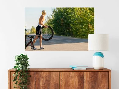 Sexy girl with a road bike and a flat tire looking for help panorama