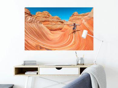 Man surfing the wave in the Arizona desert, USA.