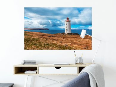 White lighthouse on the sea shore. Skardsviti Lighthouse