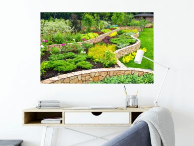 Landscaping panorama of home garden. Scenic view of landscaped garden in backyard. Landscape design with plants and flowers at residential house. Scenery of natural landscaping area in summer.