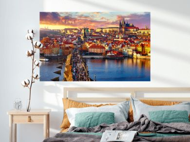 Panoramic view above at Charles Bridge Prague Castle and river Vltava Prague Czech Republic. Picturesque landscape with sunset old town houses with red tegular roofs and broach tower.