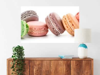 Different tasty macarons on white background