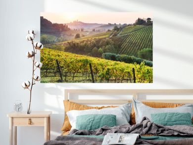 Beautiful valley in Tuscany, Italy. Vineyards and landscape with San Gimignano town at the background.