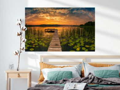 Panorama of beautiful sunrise over lake