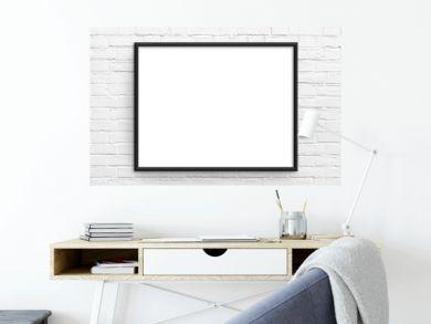 Empty frame. Blank black landscape frame on white brick wall