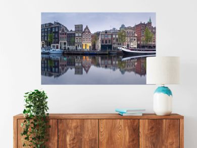 Cityscape of Amsterdam with reflection of buildings on water