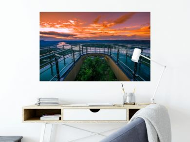A high angle abstract background from the mountains, which can see the surrounding scenery (rivers, roads, communities, trees) and the evening twilight from the beautiful sky.