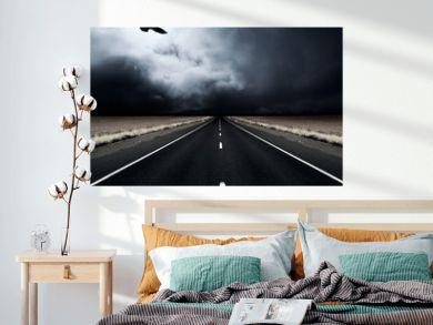 A bird flies away from an incoming storm