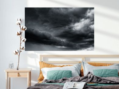 Dramatic thunder storm clouds at dark sky