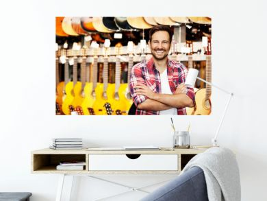 Salesperson in musical instruments store