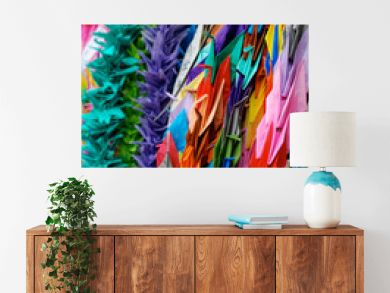 Strings of colorful paper cranes