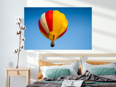 Colorful of Hot air balloon with fire and blue sky background