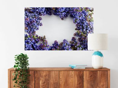Spring frame with flower of lilac. Frame of beautiful flowers on a gray wooden surface. Vintage toning. With copy-space