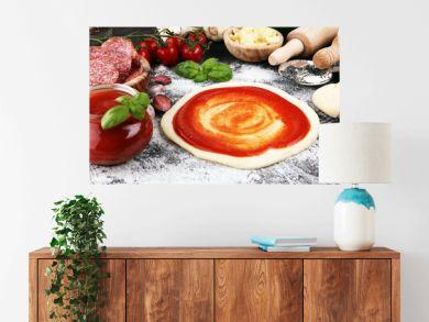 Fresh original Italian raw pizza preparation with fresh ingredients