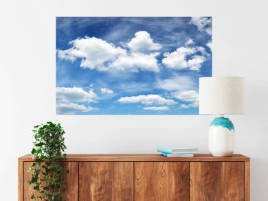 white fluffy clouds on blue sky in summer on sunny day