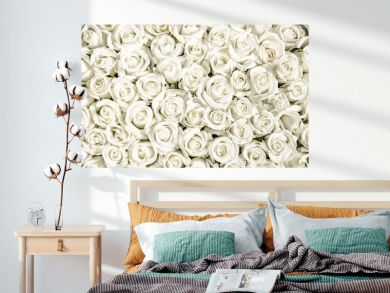 Many white roses are a top view. Vintage style.