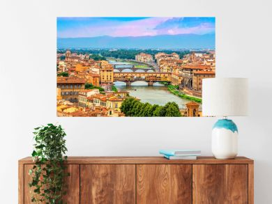 Aerial view of medieval stone bridge Ponte Vecchio over Arno river in Florence, Tuscany, Italy. Florence cityscape. Florence architecture and landmark.