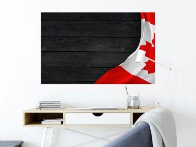Flag of the Canada, fabric on dark wood.