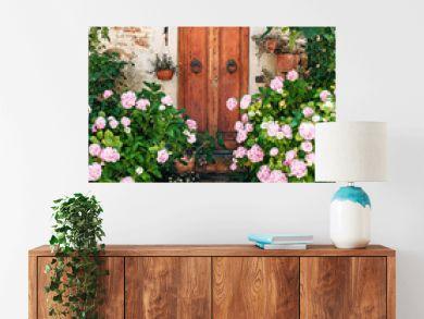 door with flower Pienza town, world UNESCO heritage, Europe, Italy, Tuscany