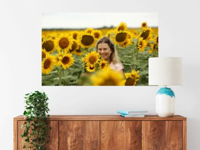 woman in a field with a sunflower, close-up, portrait