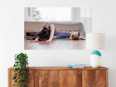 woman practice yoga with dog pug breed