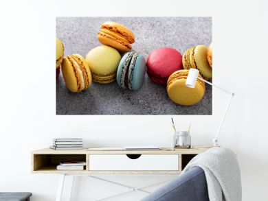 Variety of colorful macarons on the table, french dessert