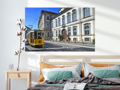 palazzo storico e tram a milano in italia, historical palace and streetcar in milan city in italy