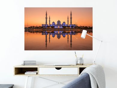 Sheikh Zayed Grand Mosque in Abu Dhabi with a water reflection angle, there is light before the sunset is very beautiful