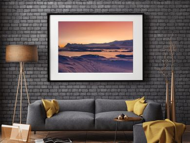 Antarctica sunset panoramic view. Epic bays surrounded by the snow covered land with the animal footprints. Breathtaking polar scenery. Ideal background for the winter collages and illustrations.