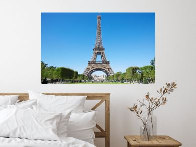 Eiffel tower, sunny summer day with blue sky and green Field of Mars