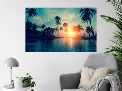 Fantastic sunset, palm trees in tropical beach.