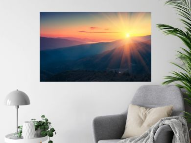 Panoramic view of  colorful sunrise in mountains. Filtered image:cross processed vintage effect.