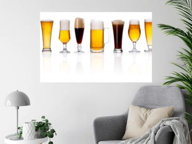 set of frosty glass of light beer with foam on white