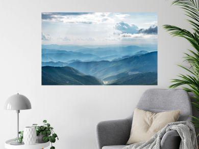 Mountain landscape with sun beams in ukrainian Carpathiaan