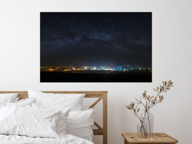 Panoramic view of the starry night sky above the city.