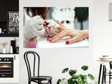Young woman doing manicure in salon. Beauty concept.