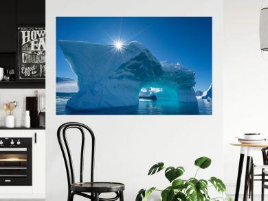 Iceberg and a sun in Antarctica