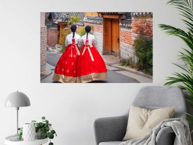 Korean lady in Hanbok or Korea dress and walk in an ancient town in seoul