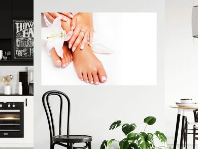 manicure pedicure with flower lily closeup isolated on white perfect shape hands spa salon