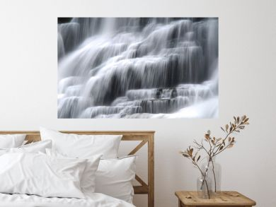 Cascading waterfall with smooth flowing water