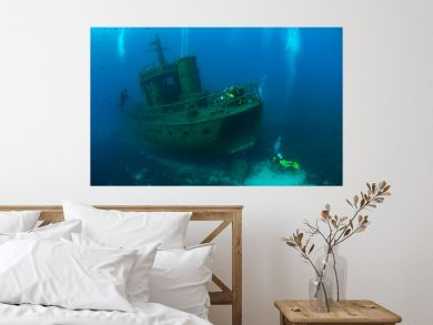 ship wreck underwater.scuba diver taking photos ship wreck underwater