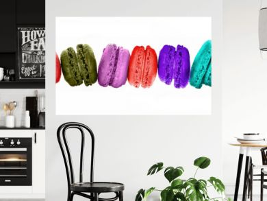 Row of colorful macarons isolated on panoramic white background