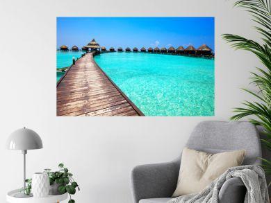 Maldives. .Villa on piles on water.