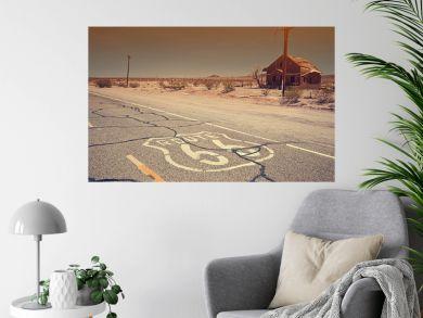 Route 66 pavement sign sunrise in California's Mojave desert.
